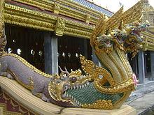220px-Phra_Maha_Chedi_Chai_Mongkol_Naga_emerging_from_mouth_of_Makara
